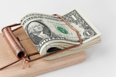 13510403-many-american-dollar-bills-in-mouse-trap-debt-trap